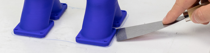 how to properly remove prints from the printing surface